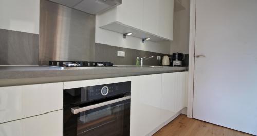 Greeploze Keuken Wit Mat : Greeploze Witte Keuken Witte keuken greeploos hoogglans i